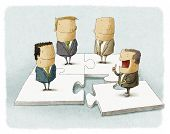 stock photo of tangram  - People as pieces of a business puzzle - JPG