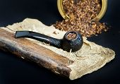 stock photo of tobacco-pipe  - Smoking pipe with smoking tobacco on very old book