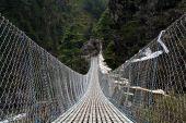 picture of sherpa  - Pendant bridge with buddhist prayer flags in Himalaya - JPG