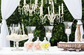 picture of dessert plate  - Candy bar at wedding reception with many desserts and sweets - JPG