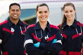 image of jumpsuits  - beautiful young EMT and colleagues in front of ambulance - JPG