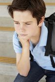 stock photo of pre-teen boy  - Unhappy Pre teen boy at school - JPG