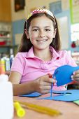 pic of pre-teen girl  - Pre teen girl in art and craft class - JPG