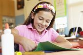 stock photo of pre-teen girl  - Pre teen girl in art and craft class - JPG