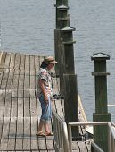 Woman On Pier Crop poster