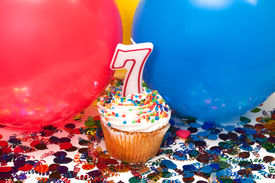 pic of number 7  - Celebration with balloons confetti cupcake and number 7 candle - JPG