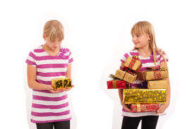 stock photo of sarcastic  - Girl with lots of gifts looking at another girl sarcastically having only a small gift and disappointed - JPG