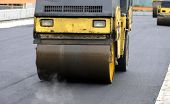foto of construction machine  - Street paver with rollers and paving machines