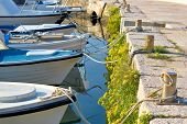 pic of bollard  - Boats tied at the marina  - JPG