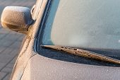 stock photo of ice-scraper  - Frosty patterns on a completely covered car windscreen - JPG