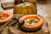 picture of hollow  - Cream of pumpkin soup with pumpkin seeds and and garlic croutons  in hollowed - JPG