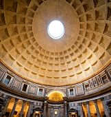 picture of church interior  - Interior of Rome Pantheon with the famous ray of light from the top - JPG