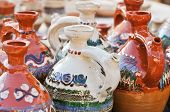 picture of pottery  - Romanian traditional pottery handcrafted mugs at a souvenir shop - JPG