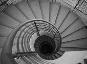 stock photo of spiral staircase  - Image Of Granite spiral staircase inside building - JPG