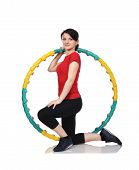 stock photo of hula hoop  - fitness girl kneeling with color hula hoop - JPG