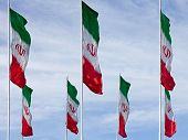 picture of iranian  - Rows of waving Iranian flags against cloudy blue sky - JPG