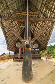 stock photo of funeral home  - Detail of the facade of a traditionally decorated public church in Tana Toraja  - JPG