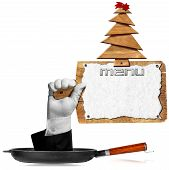 pic of comet  - Hand coming out from a pan and holding a wooden cutting board with sheet of white paper and wooden Christmas tree with red comet - JPG