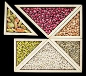 pic of tangram  - variety of beans and  lentils in a wooden tray inspired by Chinese tangram puzzle - JPG