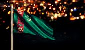 stock photo of turkmenistan  - Turkmenistan National Flag City Light Night Bokeh Background 3D - JPG