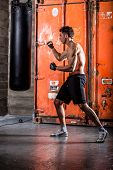 picture of pugilistic  - Young man boxing workout in an old building - JPG