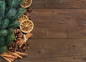 stock photo of christmas spices  - Christmas composition with spices and branches on wood - JPG