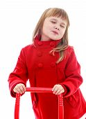 stock photo of minx  - Charming little girl in a red coat close up - JPG