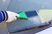 stock photo of scrape  - scraping the windshield of a car at winter - JPG