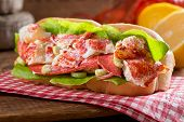 foto of crustacean  - A delicious freshly made lobster roll with lobster lemon celery and mayonnaise - JPG