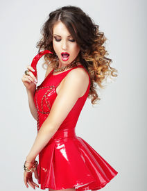 foto of carnal  - Provocative Female in Red Clothes with Hot Chili Pepper - JPG