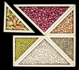 stock photo of tangram  - variety of beans and  lentils in a wooden tray inspired by Chinese tangram puzzle - JPG