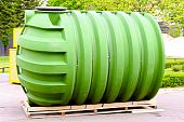 stock photo of cistern  - Big green tank for underground liquid storage - JPG