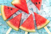 picture of popsicle  - watermelon popsicle yummy fresh summer fruit sweet dessert on vintage old wood teak blue - JPG