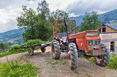image of tractor trailer  - Tractor with trailer parked on a hillside in Boussenac France - JPG