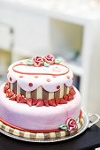 picture of cream cake  - Beautiful wedding cake in different colors with two levels and marzipan roses. Icing with cream marzipan details of cake. ** Note: Shallow depth of field - JPG