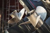 foto of outboard  - Close up two boat propeller in the marine - JPG