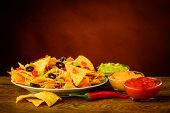 stock photo of dipping  - tortilla chips still life with salsa cheese and guacamole dip - JPG