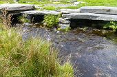 picture of paving stone  - Water or stream flowing below stone paved bridge - JPG