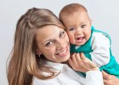 picture of mums  - The happy young mum with the baby  - JPG