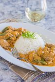picture of curry chicken  - Chicken thighs and green bell peppers in panang curry sauce served with rice - JPG