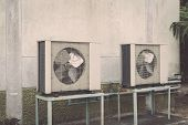 stock photo of air compressor  - Outdoor Air conditioning compressor near the wall - JPG