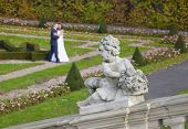 pic of cupid  - Cupid and just married couple in the background, Wilanow Park, Warsaw, Poland