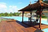 stock photo of gazebo  - Gazebo by the pool in Hotel Saman Villas - JPG