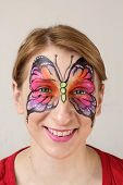 foto of face painting  - Smiling young blond girl with face painting Butterfly - JPG