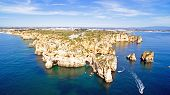 stock photo of lagos  - Aerial from Ponta Piedade with the lighthouse in Lagos Portugal - JPG