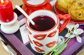 image of mug shot  - Lip patterned tea mug and corn bread on a tray shot closeup - JPG