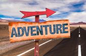 picture of wild adventure  - Adventure sign with road background - JPG