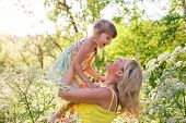 foto of daughter  - Happy family outdoors in summer forest mother and kid child daughter smiling hugging - JPG