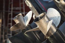 foto of outboard engine  - Close up two boat propeller in the marine - JPG