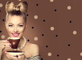 picture of bowing  - Beauty fashion model girl drinking coffee or tea - JPG